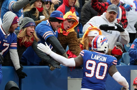 Bills Shaq Lawson is congratulated by fans after his second sack against the Broncos.