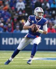 Bills quarterback Josh Allen sets up in the pocket looking downfield.