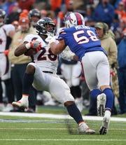 Bills linebacker Matt Milano makes the tackle on Broncos running back Royce Freeman after a short gain.