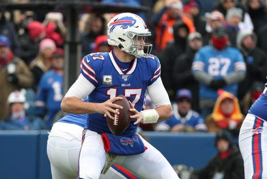 Bills quarterback Josh Allen looks downfield against the Broncos.