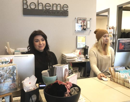 Store manager Kristi Lynn, left, and employee Hannah Antonsen work at the counter of Boheme Salon & Spa on Dana Drive on Tuesday, Nov. 26, 2019. The shop is one of many in Redding that will participate in Small-Business Saturday to offer discounts and host a scavenger hunt.
