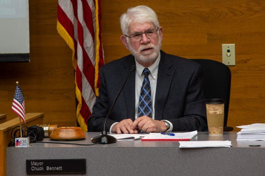 Mayor Chuck Bennett reacts to an audience member's question during a City Council meeting on Nov. 25 in downtown Salem. The city took a preliminary vote not to ban the people from sitting and lying on public sidewalks, on Monday night.