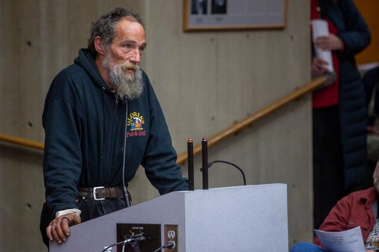 A man who has lived through homelessness rejects the sit-lie ordinance during public comment of the City Council meeting on Nov. 25 in downtown Salem. The city took a preliminary vote not to ban the people from sitting and lying on public sidewalks, on Monday night.