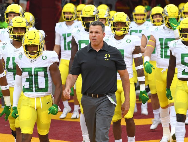 Nov 2, 2019; Los Angeles, CA, USA; Oregon Ducks head coach Mario Cristobal leads his team on to the field for the game against the USC Trojans at Los Angeles Memorial Coliseum. Mandatory Credit: Jayne Kamin-Oncea-USA TODAY Sports