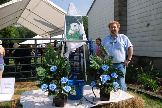 In this 2009 photo, Nightmist's owner Michael Pryor stands next to a memorial dedicated to Nightmist displayed at Beebe Ranch. Nightmist was born July 9, 1998 and died suddenly May 14, 2009.
