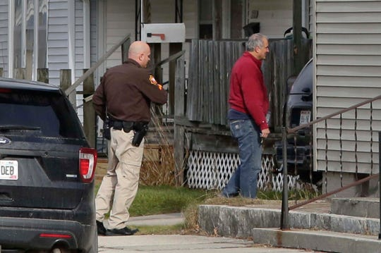 Authorities arrive with eviction papers at an upper flat along S. 12th St., Tuesday, November 26, 2019, in Sheboygan, Wis.
