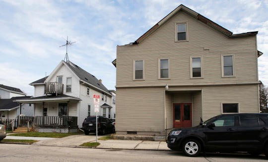 The exterior of an upper flat, left in white, along S. 12th St., Tuesday, November 26, 2019, in Sheboygan, Wis.