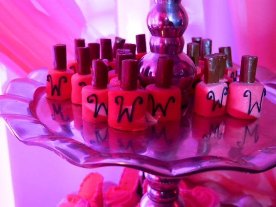 Nail polish bottles inspired fondant confections offered in the sweet treat corner of the birthday party.