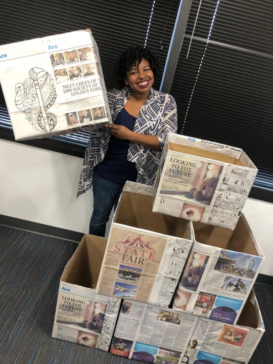Times Reporter Tiana Kennell shows off boxes which will be posted around town for collection of art supplies for Renzi Education & Art Center. The collection is a Times project spearheaded by Kennell.