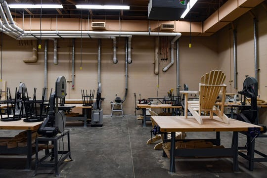 A partially constructed Adirondack chair sits in the woodshop on Tuesday, Nov. 26, at Harrisburg High School.