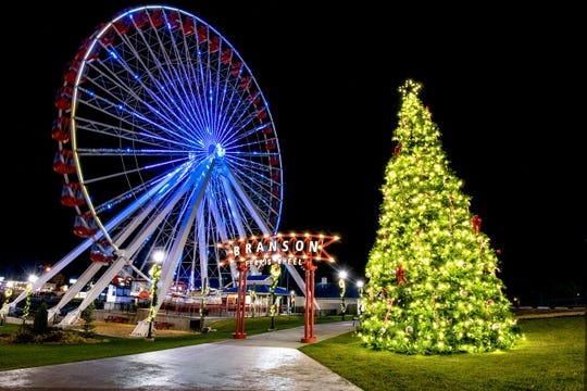 This stunning tree glows with the backdrop of the Ferriss wheel in Branson.