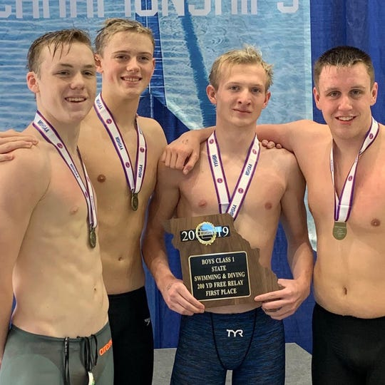 Jack Beatty, Colin McNew, Andrew McIllwain and Michael Jasinski won first place in the 200 Free Relay.