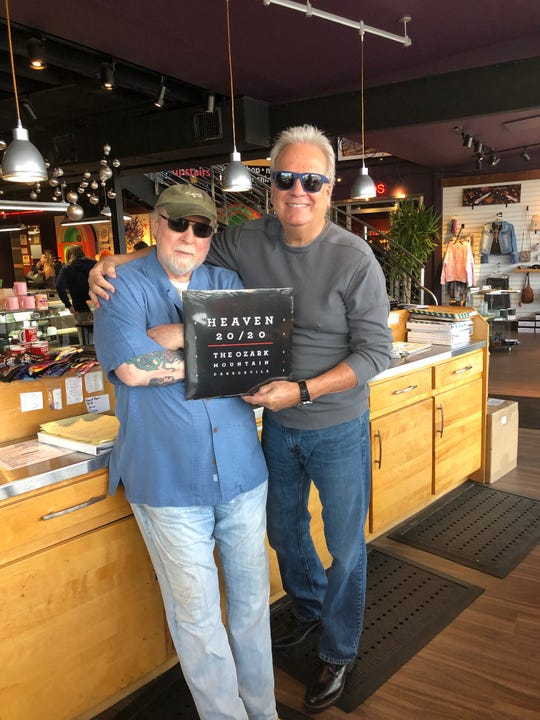 "The Ozark Mountain Daredevils recently released a vinyl version of their 2019 album, ""Heaven 20/20."" In this publicity photo longtime Daredevils singer-lead guitarist John Dillon (right) shows off a copy of the vinyl release with Tom Pierson, owner of Kaleidoscope in Springfield, Mo."
