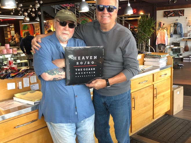 """The Ozark Mountain Daredevils recently released a vinyl version of their 2019 album, """"Heaven 20/20."""" In this publicity photo longtime Daredevils singer-lead guitarist John Dillon (right) shows off a copy of the vinyl release with Tom Pierson, owner of Kaleidoscope in Springfield, Mo."""