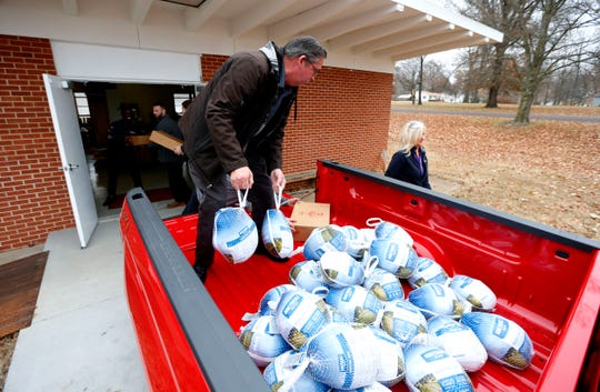 Jack Spencer, a salesperson at Reliable Chevrolet, unloads turkeys that Reliable Chevrolet donated to the Grand Oak Baptist Mission Center food pantry in West Springfield on Tuesday, Nov. 26, 2019.