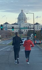 Tyler Moon, left, and Amy Greene finish the final two miles of their makeup Twin Cities 10 Mile race Nov. 2. Finishing the race was one of his 2019 New Years resolutions.