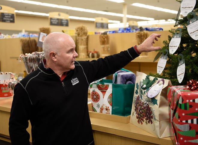 "Jason Crane, owner of Home Instead Senior Care in Waite Park, talks about his company's ""Be a Santa to a Senior"" program Tuesday, Nov. 26, 2019, at Lunds & Byerlys St. Cloud."