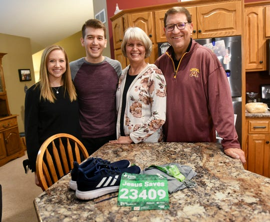 Tyler Moon is photographed with his fianceŽ Amy Greene and parents Jeff and Kay Moon Saturday, Nov. 23, 2019, in Sauk Rapids.