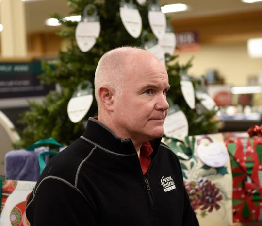 """Jason Crane, owner of Home Instead Senior Care in Waite Park, looks on before describing his company's """"Be a Santa to a Senior"""" program Tuesday, Nov. 26, 2019, at Lunds & Byerlys St. Cloud."""