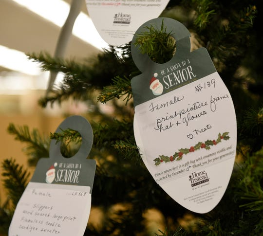 """The """"Be a Santa to a Senior"""" program is as simple as picking up a paper ornament and returning a gift for the elderly at Lunds & Byerlys St. Cloud, shown here on Tuesday, Nov. 26, 2019."""