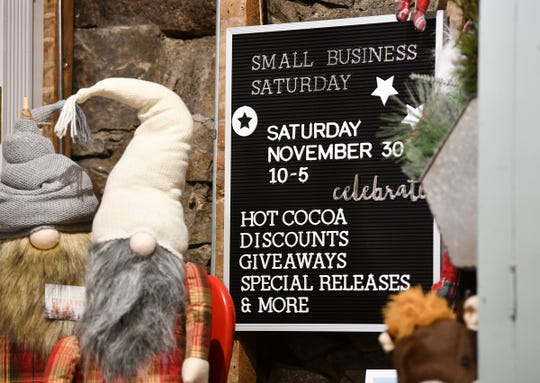 A sign lists events planned for Small Business Saturday on Friday, Nov. 22, 2019, at Copper Pony in downtown St. Cloud.