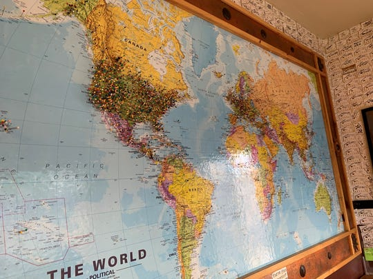 A map at Veyo Pies has pins for all the places customers have come from that have visited the shop.