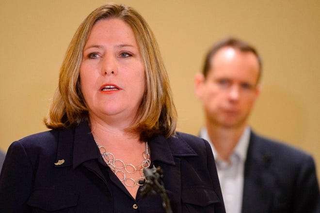 Jill McCluskey speaks at a news conference in Salt Lake City on Monday, Nov. 25, 2019. Jill and Matthew McCluskey, back right, parents of Lauren McCluskey, a University of Utah student and track athlete who was fatally shot on campus, are fighting a claim by the college that their lawsuit should be dismissed because their daughter's killer wasn't a student. (Trent Nelson/The Salt Lake Tribune via AP)