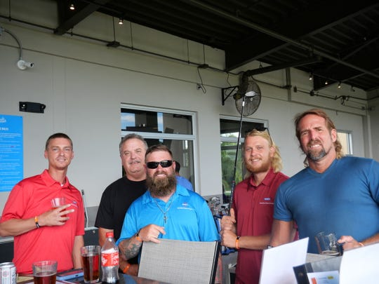 """Chris McAlpin, left, Dave Taylor, James Patterson, Kevin Vlatos and Bob Gray at Indian River Habitat for Humanity's """"We Golf Fore Habitat"""" scholarship program fundraiser at BigShots Golf in Vero Beach."""