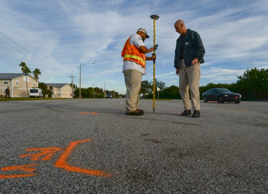 "David Farquharson (right), a traffic homicide investigator with the Vero Beach Police Department, works with Dan Rodriguez, of the City of Vero Beach, on Tuesday, Nov. 26, 2019, as they use the city's GPS technology to map out a fatal crash scene that occurred Friday on Indian River Boulevard at 18th Street in Vero Beach. ""It allows us to mark spots in the roadway, via GPS markings, so we can go back later on and put those specific points on areas of the roadway to indicate where certain marks were, whether they be skid marks, gouge marks, fluid spills, [and] allows us to follow the path of the vehicle through the crash scene,"" Farquharson said. ""It helps us to reconstruct the crash scene so we can better determine what happened after impact, which helps determine what happened prior to impact, and at impact."""