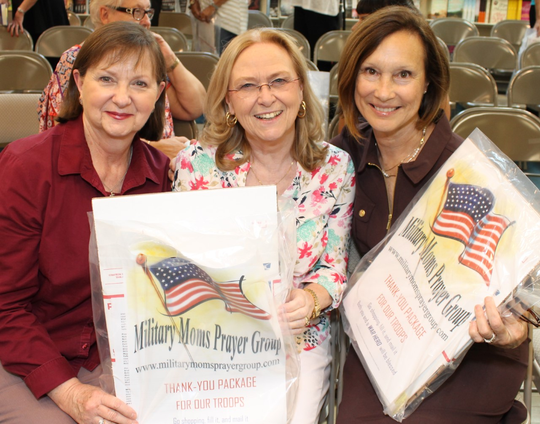 Military Moms Prayer Group members Becky Jones, left, Patti Voyles and Margy Kulczycki with ready-made mailing kits to send packages to the troops. The kits are available through Dec. 15, 2019, at locations in Vero Beach and Sebastian.