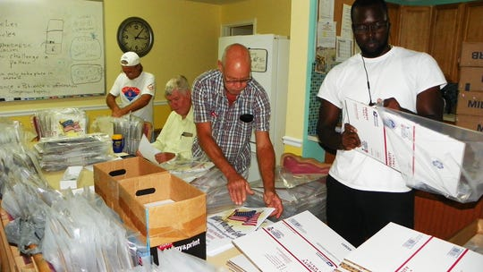 "Residents at Camp Haven helping put together the ""Holidays for Heroes"" mailing kits now available at locations throughout Vero Beach and Sebastian until Dec. 15, 2019."