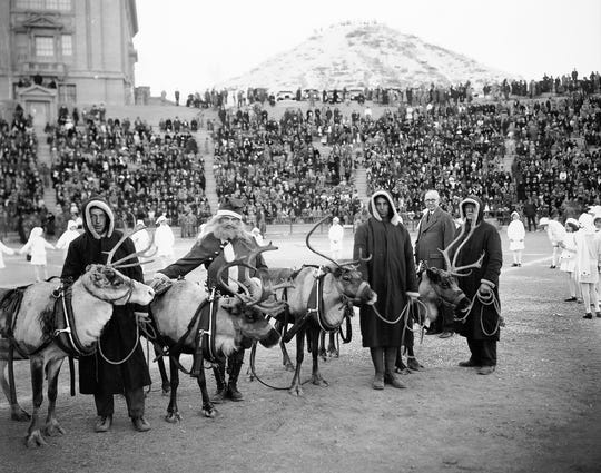 Dec. 24, 1928: Here are Dancer, Prancer, Donner and Blitzen, just after they were presented to the children of El Paso at Sunday's Christmas party. Santa Claus himself presented them. Mayor R.E. Thomason (shown in background) accepted them, on behalf of the children. Child dancers, dressed as snow drops, are shown encircling Santa and his reindeer.