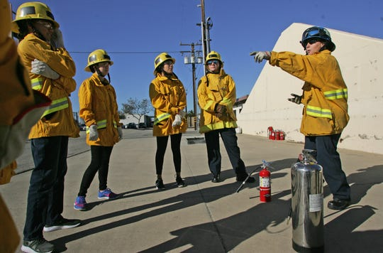 Instructor Brenda Pasqua explains how to use a fire extinguisher on Nov. 23, 2019, during a two-day girls' fire camp at the Camarillo Airport.