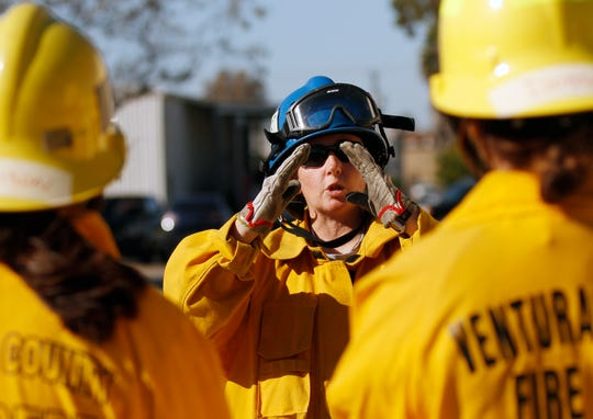 Instructor Brenda Pasqua explains how a fire grows while teaching students how to extinguish a flame on Nov. 23, 2019, during a two-day girls' fire camp at the Camarillo Airport.