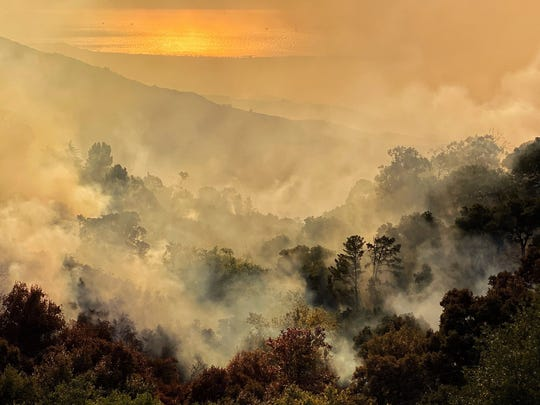In this file photo, smoke permeates the area around the Cave Fire in Santa Barbara just before Thanksgiving.