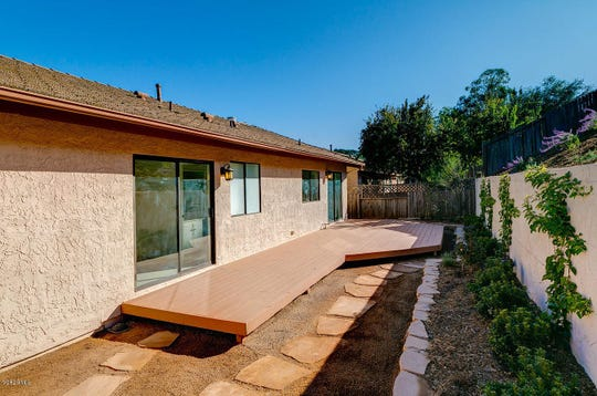 This Ojai home for sale for $589k includes a large back deck.