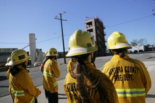 Students participate in a skills station on Nov. 23, 2019, during a two-day girls' fire camp where 14- to 18-year-olds can get a taste of what a firefighting career is like. The camp is held at the regional fire training center at the Camarillo Airport.