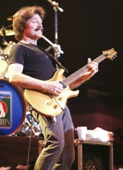 Visalia native Tom Johnston plays with the Doobie Brothers at a 2005 concert at the Visalia Fox Theatre.