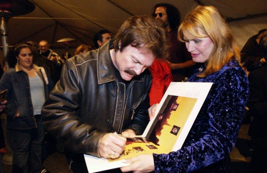 Visalia native Tom Johnston signs autographs at the Visalia Fox Theatre in 2005.