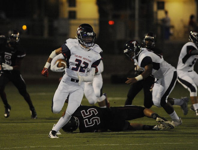 Tulare Western's Casey Bernardo (32) looks for running room during a game at Giant Chevrolet-Cadillac Mineral King Bowl in this 2014 file photo. Tulare Western won 27-18.