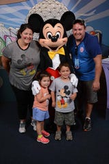 Cassandra and Curtis Carney of Tappan, New York, with their children, Gabriella and Matthew, during a 2017 trip to Disney World made possible by Baking Memories 4 Kids.