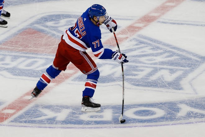 New York Rangers' Tony DeAngelo (77) shoots during the third period of an NHL hockey game against the Minnesota Wild, Monday, Nov. 25, 2019, in New York. (AP Photo/Frank Franklin II)