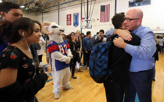 Students say goodbye to Principal Lou Riolo after a rally in his honor on his last day at Carmel High School on Tuesday. Riolo is taking a job at Putnam-Northern Westchester BOCES as an assistant superintendent.