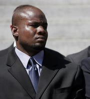 Probationary police officer Murashea Bovell, 28, listens as Mount Vernon officials swear in his recruit class on July 25, 2007 on the steps of City Hall.