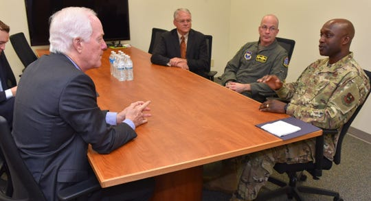 U.S. Sen. John Cornyn, left, talks with Col. Kenyon Bell, 82nd Training Wing commander, right, Col. Russell D. Driggers, 80th Flying Training Wing commander, second from right, and former Wichita Falls Mayor Glen Barham, president of the Sheppard Military Affairs Committee, on Tuesday during Cornyn's visit to Sheppard Air Force Base.