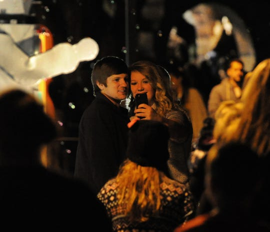 In this file photo, a young couple take a selfie during the annual lighting of the MSU-Burns Lights. Texas was listed in a recent study as the third best state for singles.