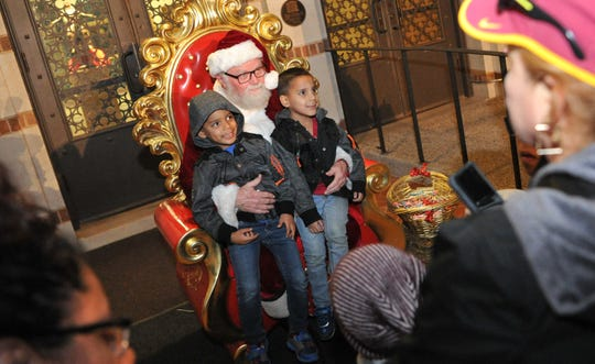 Parents and guardians brought their kids to meet Santa Claus, Monday night during the annual lighting of the MSU-Burns Christmas lights.