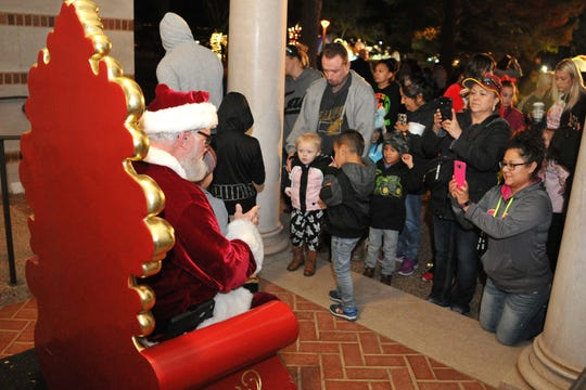 Parents and guardians brought their kids to meet Santa Claus, Monday night, during the annual lighting of the MSU-Burns Christmas lights.