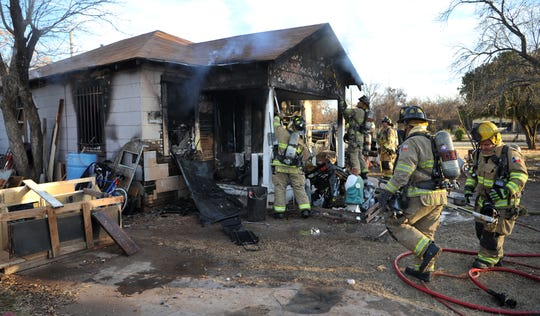 Wichita Falls firefighters worked to contain a house fire Monday afternoon at a home located in the 1200 block of Tulip.