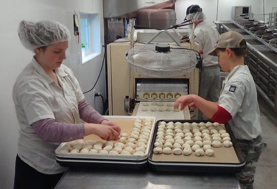 Balls of dough are placed on sheet pans. Each day the Gitto family turns out around 6000 tortillas, packaged and ready to deliver.